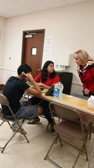 This provided photo was posted to Mary Fallin's Twitter account Friday, June 20, 2014, depicting Fallin sitting in with a caseworker at Fort Sill who was helping an immigrant minor try to reach relatives in the U.S.