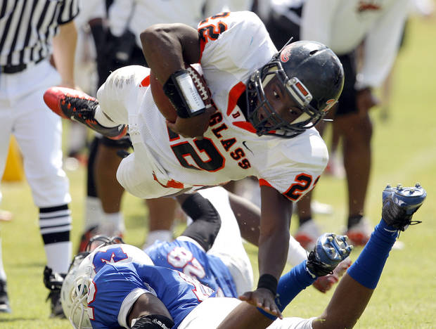 photo - Douglass' Chris High leaps over Millwood's Alfonso McMillan during the high school football game between Millwood and Douglass at Millwood High School in Oklahoma City, Saturday, Sept. 10, 2011. Photo by Sarah Phipps, The Oklahoman  ORG XMIT: KOD