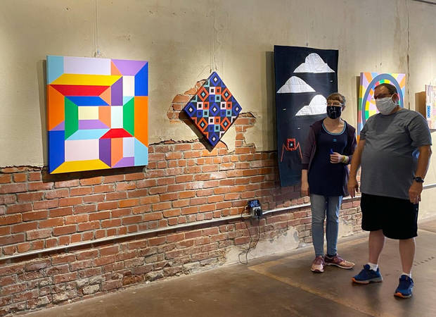 "Quilter Sarah Atlee and Jason Wilson, to members of the Oklahoma artist collaboration Qu'aint, talk about the collective's ""Convergence"" exhibit at The Vault Art Space and Gathering Place in Pauls Valley. [Photo provided]"