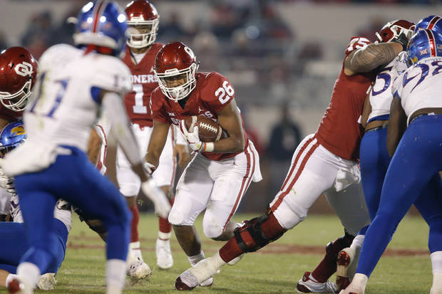 Oklahoma's Kennedy Brooks (26) carries the ball during a college football game between the University of Oklahoma Sooners (OU) and the Kansas Jayhawks (KU) at Gaylord Family-Oklahoma Memorial Stadium in Norman, Okla., Saturday, Nov. 17, 2018. Photo by Bryan Terry, The Oklahoman