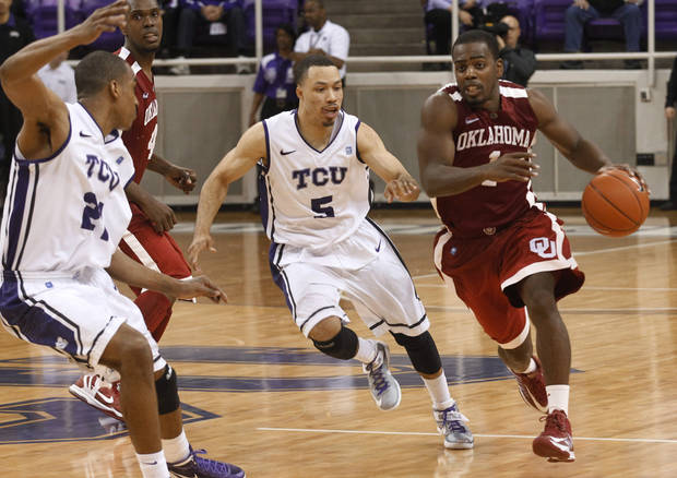 photo - Oklahoma guard Sam Grooms (1) brings the ball up against TCU guard Kyan Anderson (5) in the final seconds of of an NCAA college basketball game Saturday, March 9, 2013, in Fort Worth, Texas. (AP Photo/Fort Worth Star-Telegram, Rodger Mallison) ORG XMIT: TXFOR403