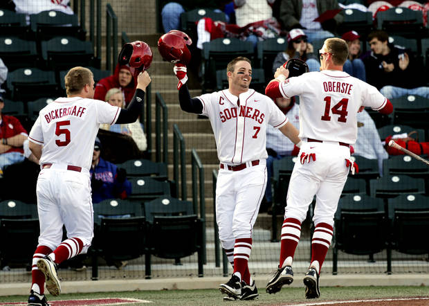 photo - Colt Bickerstaff, left, Max White, center, and Matt Oberste meet at the plate after all three runners scored on a double by Anthony Hermelyn as the University of Oklahoma (OU) Sooners play Hofstra in NCAA college baseball at L. Dale Mitchell Field on Friday, Feb. 15, 2013  in Norman, Okla. Photo by Steve Sisney, The Oklahoman