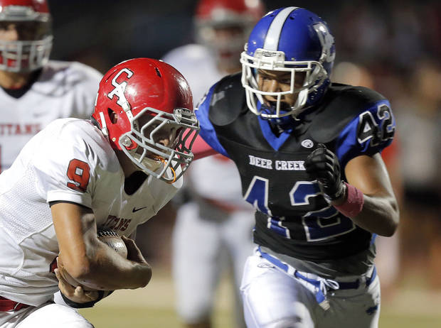 photo - Carl Alber&#039;s Caleb Toney rushes up field as Deer Creek&#039;s Alec James looks to make a tackle during the high school football game between Deer Creek and Carl Albert at Deer Creek High School, Friday, Sept. 21, 2012.  Photo by Sarah Phipps, The Oklahoman