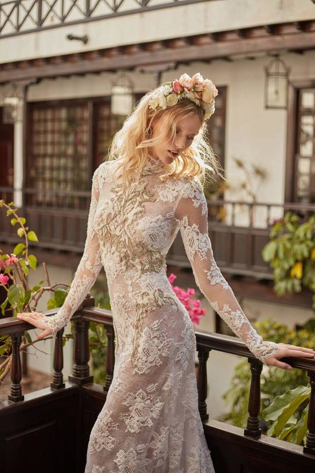 """Snow in Summer,"" a high-neck mermaid dress made of embroidered French lace with a rose motif and keyhole back cleavage. The dress is embellished with beads and crystals. By Galia Lahav."