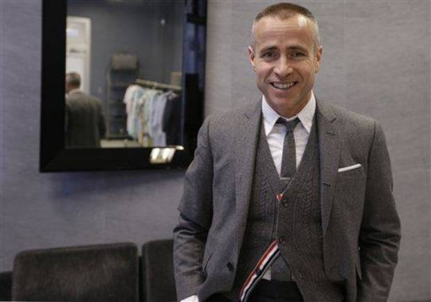 photo - Fashion designer Thom Browne poses for a photograph at his Hudson Street store in New York, Wednesday, Feb. 20, 2013. Browne is building a business _ and what he hopes is a smart, long-lasting business at that. He's just not the overzealous, mercurial artiste. (AP Photo/Kathy Willens)