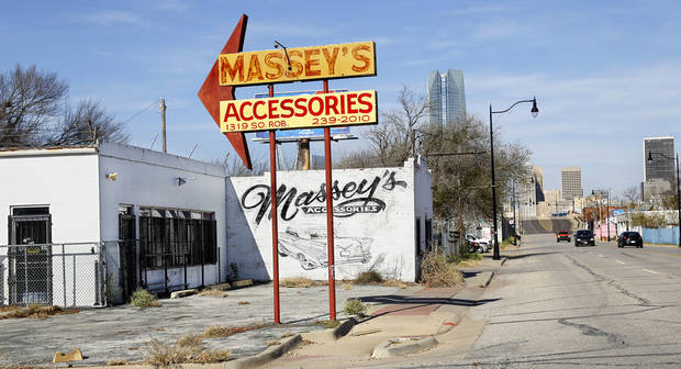 Businesses in Hubcap Alley along S Robinson Avenue were relocated to make way for the MAPS 3 downtown park. Demolition work will follow to remove remnants of the scrapyards and auto parts stores. [The Oklahoman Archive]
