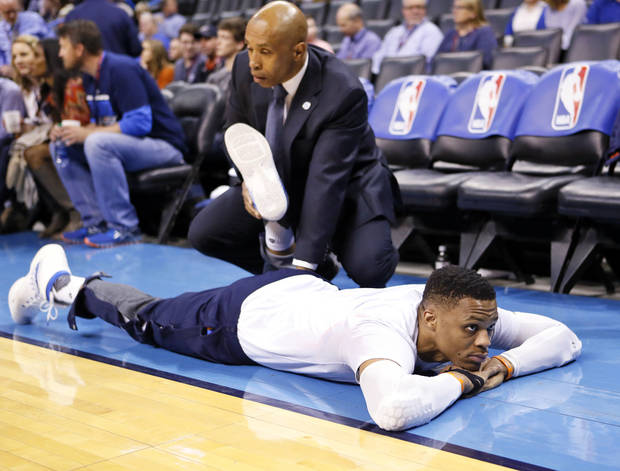 Oklahoma City's Russell Westbrook stretches before an NBA basketball game between the Oklahoma City Thunder and San Antonio Spurs at Chesapeake Energy Arena in Oklahoma City Friday