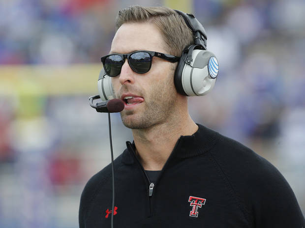 photo - Texas Tech coach Kliff Kingsbury watches play from the sidelines during the first half of an NCAA college football game against Kansas in Lawrence, Kan., Saturday, Oct. 5, 2013. (AP Photo/Orlin Wagner)