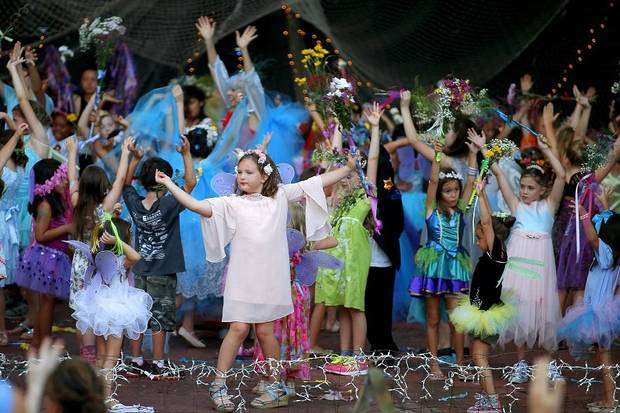 Children dance on stage during the 2019 Fairy Ball, presented by Theatre Upon a StarDanceSwan at the Crown Jewel Amphitheater at First Christian Church in Oklahoma City, Saturday, June 29, 2019. [Bryan Terry/The Oklahoman Archives]