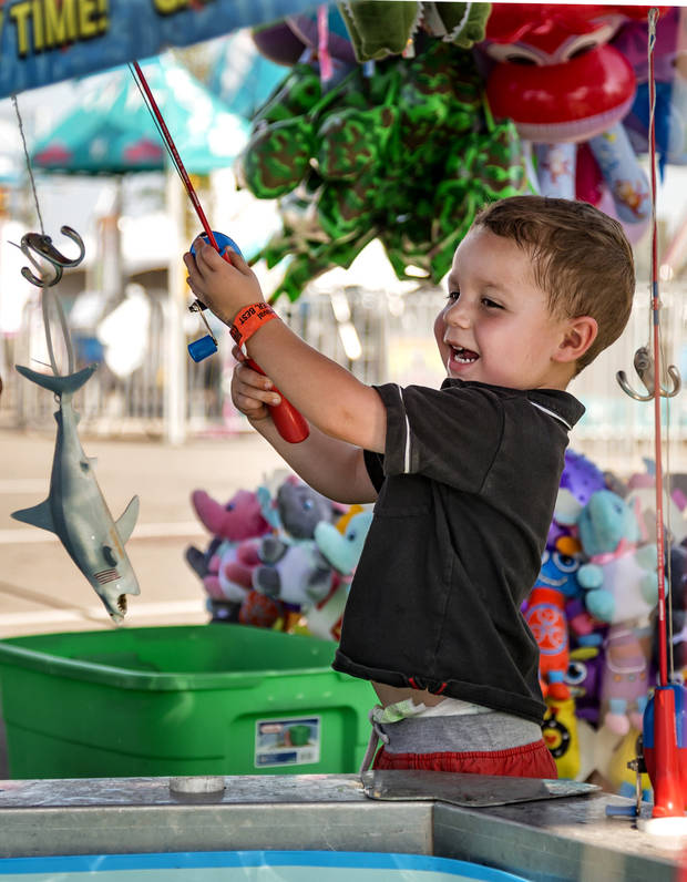 Benjamin Tedrow joined in the fun at the 2017 Oklahoma State Fair in Oklahoma City. [Photo by Chris Landsberger, The Oklahoman]