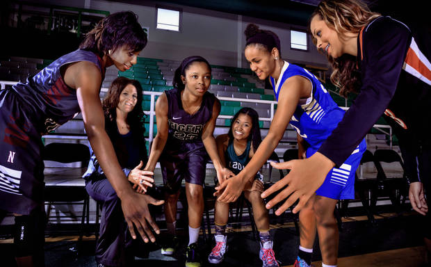 photo - Super Five Girls Team: Northeast Academy's LaNesia Williams, Deer Creek coach Totsy Manning, Broken Arrow's Toree Thompson, Edmond Santa Fe' Tamare Lee, Choctaw's Ana Llanusa and Preston's Chelsea Dungee, from left, pose for a photo in Oklahoma City, Okla. on Wednesday, April 2, 2014. Photo by Chris Landsberger, The Oklahoman