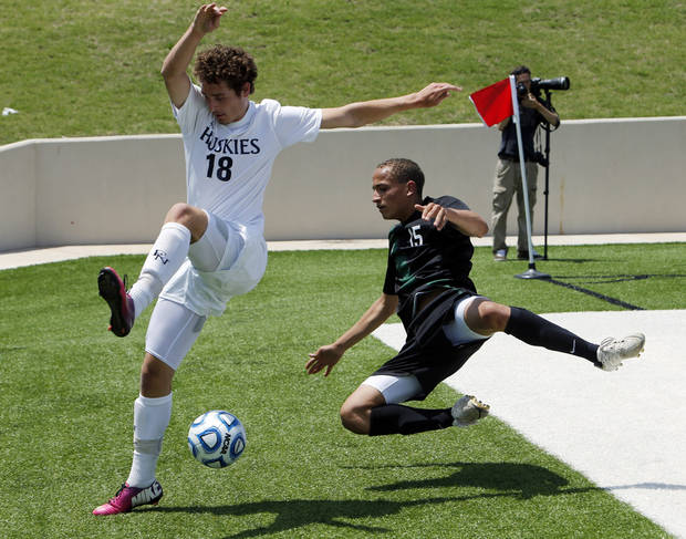 photo - Edmond North's Clay Collier, (18) and Jacob Jerles chase the ball out of bounds in the Class 6A boys state soccer championship game between Edmond North and Norman North on Saturday, May 11, 2013 in Noble, Okla.  Photo by Steve Sisney, The Oklahoman
