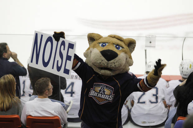 photo - AHL HOCKEY / PLAYOFFS: Barons' mascot, Derrick, interacts with the crowd during a game between the Oklahoma City Barons and the Toronto Marlies at the Cox Convention Center in Oklahoma City, Friday, May 18, 2012.  Photo by Garett Fisbeck, For The Oklahoman