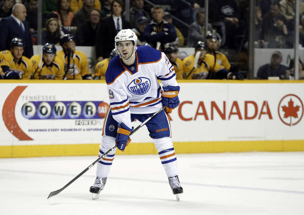 photo - Edmonton Oilers defenseman Justin Schultz plays against the Nashville Predators in the third period of an NHL hockey game on Monday, March 25, 2013, in Nashville, Tenn. The Predators won 3-2. (AP Photo/Mark Humphrey) ORG XMIT: OTK