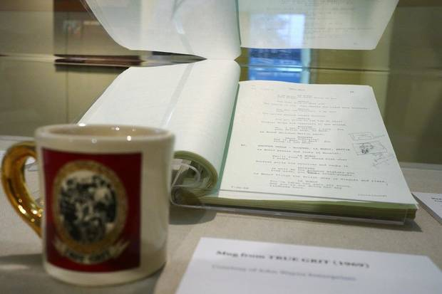 "John Wayne's personal script for his 1969 movie ""True Grit"" is featured in the National Cowboy & Western Heritage Museum's exhibit ""Two Grits- A Peek Behind the Eyepatch,"" which explores the two different films made from the 1968 novel ""True Grit"" by Charles Portis. [Photo by Doug Hoke/The Oklahoman]"