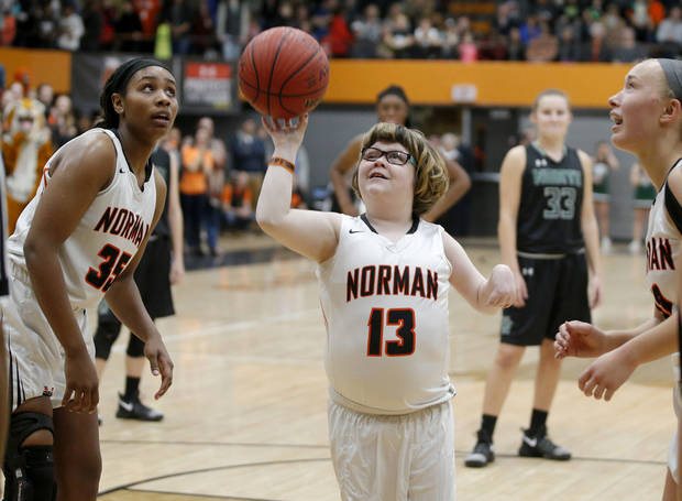 Norman's Lainy Fredrickson attempts a shot as Bethany Franks watches during a girls basketball game at Norman High School, Friday, Feb. 3, 2017. Photo by Bryan Terry, The Oklahoman