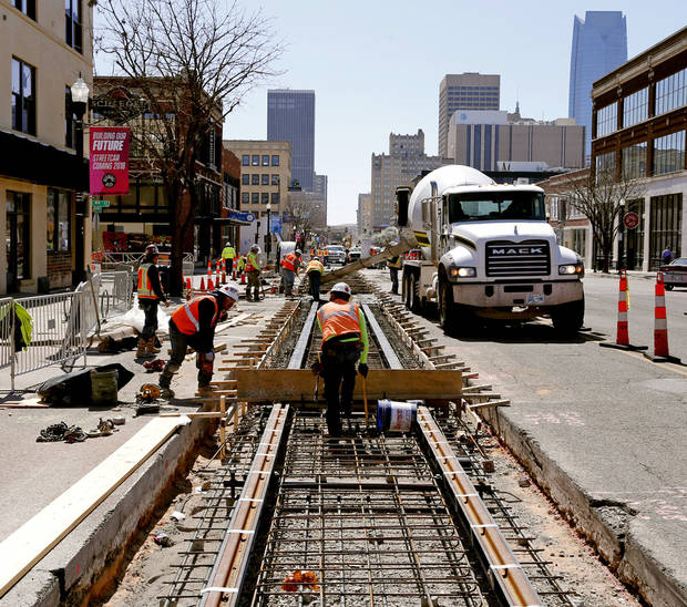 Workers with contractor Herzog/Stacy & Witbeck began construction on the Oklahoma City streetcar route in February 2017. Rails are laid in downtown streets, 22 boarding platforms are being built, overhead wires are being strung and six electrical substations have been installed and powered up. [ Photo by Steve Sisney, The Oklahoman]