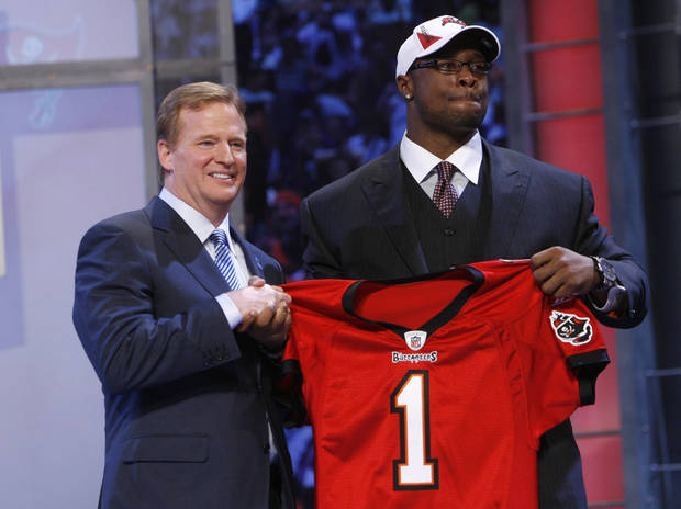photo - Oklahoma defensive tackle Gerald McCoy, right, holds up a jersey with NFL commissioner Roger Goodell  after he was selected as the third overall pick by the Tampa Bay Buccaneers in the first round of the NFL football draft at Radio City Music Hall Thursday, April 22, 2010, in New York. (AP Photo/Jason DeCrow)
