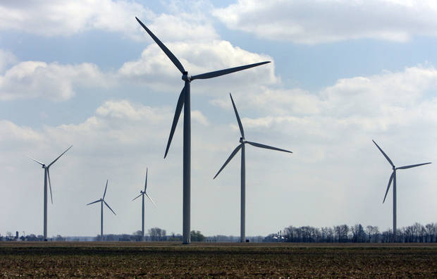 photo - FILE-- This April 21, 2008, file photo shows wind turbines at the Harvest Wind Farm in Oliver Township, Mich. State officials say Michigan is positioned to require more of its electricity to come from wind and other renewable sources. Existing law sets a 10 percent target that must be met in 2015. Michigan officials will assess the impact on the state when President Barack Obama on Monday, June 2, 2014, announces tougher new air quality standards affecting coal-fired power plants. Coal produces about 55 percent of the electricity in the state while natural gas produces 11 percent. (AP Photo/Al Goldis, File)