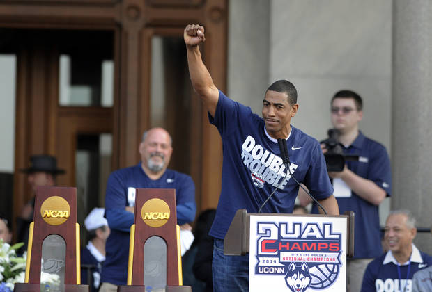 photo - Connecticut men's basketball coach Kevin Ollie gestures during a celebration of UConn's championships in the NCAA men's and women's tournaments, at a rally at the State Capitol in Hartford, Conn., on Sunday, April 13, 2014. (AP Photo/Fred Beckham)