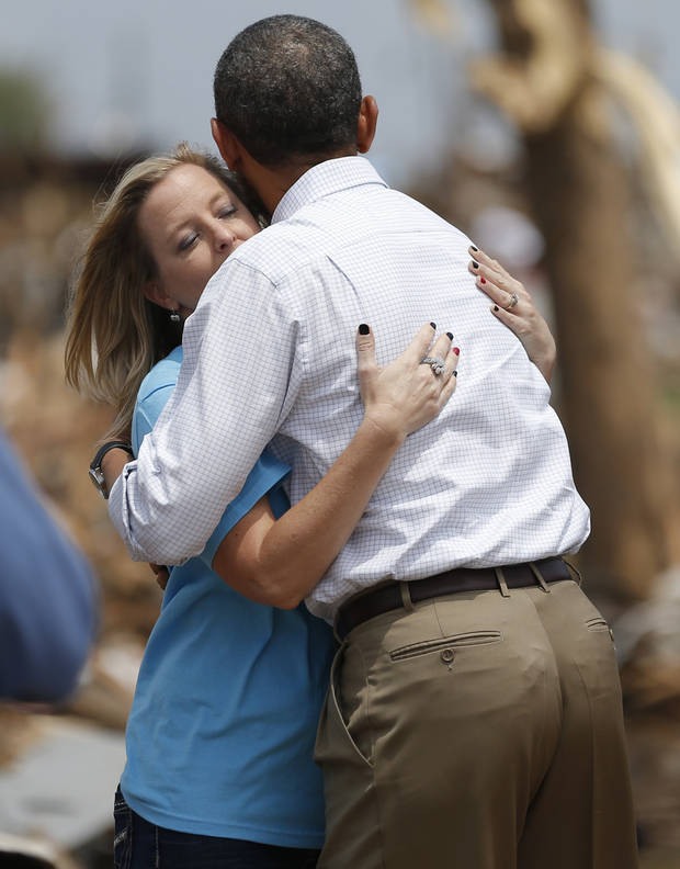 President Barack Obama hugs Plaza Towers Elementary Principal Amy Simpson on May 25, 2013 in Moore. [Photo by Bryan Terry The Oklahoman]