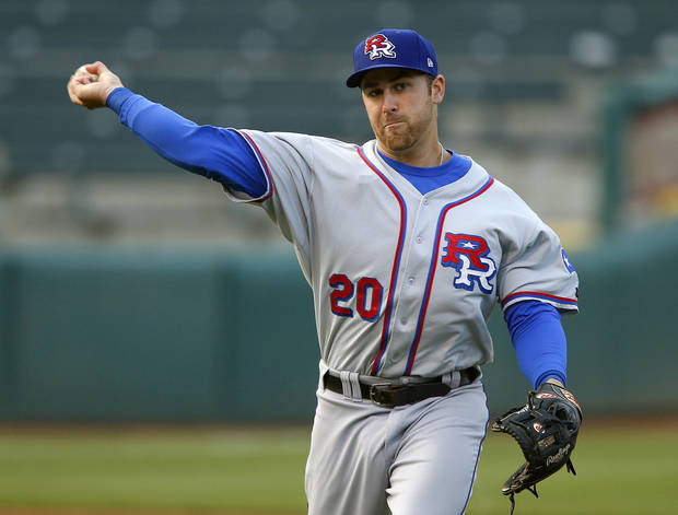 photo - MINOR LEAGUE BASEBALL: Mike Olt of the Round Rock Express throws back to first in the first inning of a baseball game against the Oklahoma City RedHawks at Chickasaw Bricktown Ballpark in Oklahoma City, Tuesday, April 16, 2013. Photo by Bryan Terry, The Oklahoman