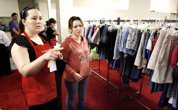 photo - Right: Carrie Coppernoll, left, helps Lillian Barron of Oklahoma City select children's clothes during the Spring Fling Event at Christmas Connection. PHOTO BY PAUL B. SOUTHERLAND, THE OKLAHOMAN