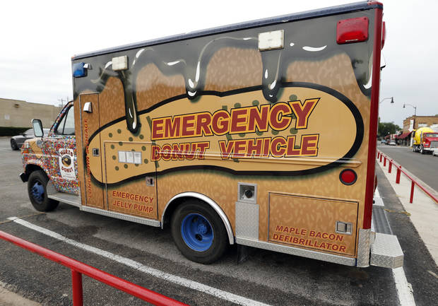 photo -  The Hurts Donut Co. delivery van (a converted ambulance) is seen Wednesday in Norman. Hurts will open a store in August at 746 Asp on Campus Corner in Norman. Photos by Steve Sisney, The Oklahoman   STEVE SISNEY
