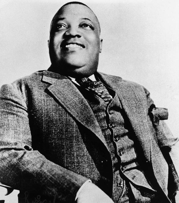 Blues vocalist Jimmy Rushing of the Count Basie orchestra is seen in a 1936 publicity photo.  (AP Photo)