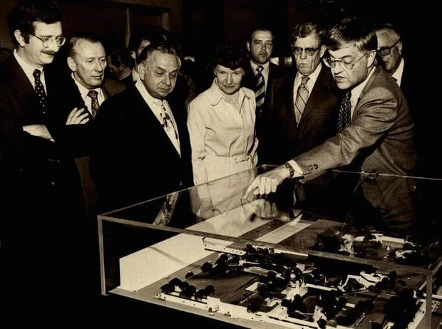 In 1976, New York architect William J. Conklin was explaining a miniature model of the Myriad Gardens project to a group of city and business leaders. Viewing the model were, from left, Councilman Neal Balkan; Paul Strasbaugh, Oklahoma City Chamber of Commerce executive vice president; Mayor Patience Latting; James G. Harlow, Chamber president; Dean A. McGee, board chairman of Kerr-McGee Corp.; and Ralph E. Bradshaw, personnel officer of the Oklahoma City Urban Renewal Authority. [Photo by Paul B. Southerland, The Oklahoman Archives]