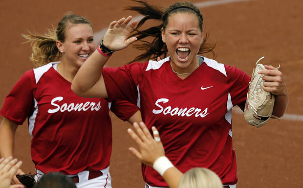 photo - Third baseman Shelby Pendley and pitcher Keilani Ricketts celebrate between innings at the NCAA Super Regional softball game as the University of Oklahoma (OU) Sooners defeat Texas A&M 8-0 at Marita Hines Field on Saturday, May 25, 2013 in Norman, Okla. to advance to the College World Series.  Photo by Steve Sisney, The Oklahoman