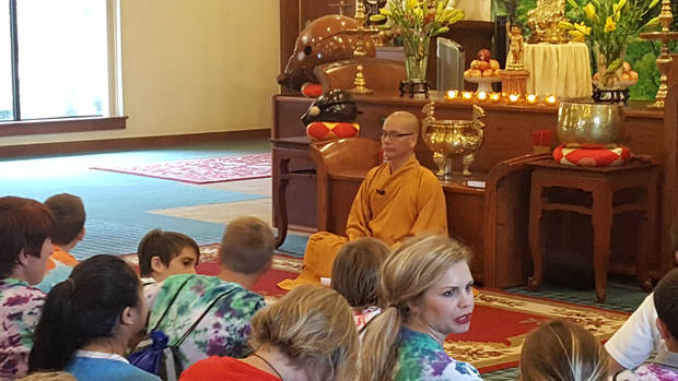 Thay Nguyen Nguyen, a monk at Gien-Giac Buddhist Temple, prepares to give a presentation about Buddhism as part of the 2106 Interfaith Youth Tour. [Photo by Carla Hinton, The Oklahoman]