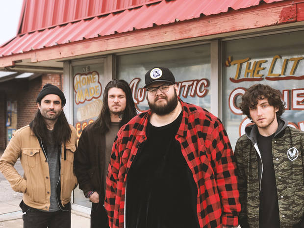 From left is Paddy Ryan, Aaron Boehler, John Moreland and John Calvin Abney. The quartet is about to hit the road with Deer Tick. [Photo provided]
