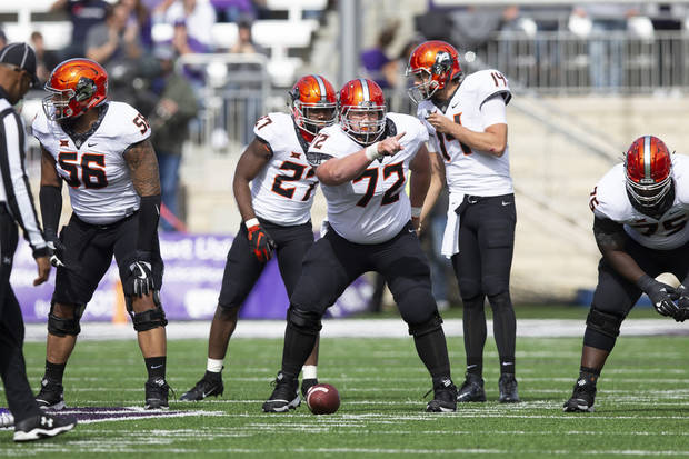 The Oklahoma State offensive line prepares for a play during the first half Saturday in Manhattan, Kansas. [PHOTO BY BRUCE WATERFIELD, Courtesy OSU Athletics]