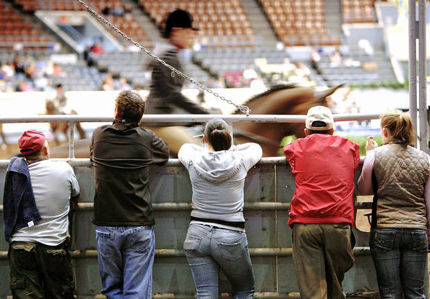 photo - Trainers watch a rider and horse compete in a recent show at State Fair Arena. OKLAHOMAN ARCHIVE PHOTO BY JIM BECKEL