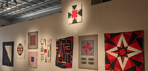 "Quilts inspired by McAlester painter Jason Wilson's painting ""Intersection (Red),"" at top, are shown in the exhibit ""Convergence"" at The Vault Art Space and Gathering Place in Pauls Valley. The exhibit features work by Qu'aint, a collaboration of Wilson and seven Oklahoma quilters. [Photo provided]"