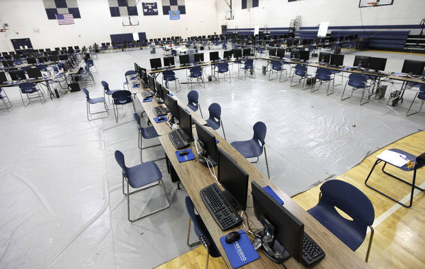 photo - These computer testing stations are set up in the gym at Edmond North High School in Edmond, OK, Tuesday, April 30, 2013. Students who were supposed to take tests today cannot use the computers because the server crashed, so now the computers sit unused. By Paul Hellstern, The Oklahoman