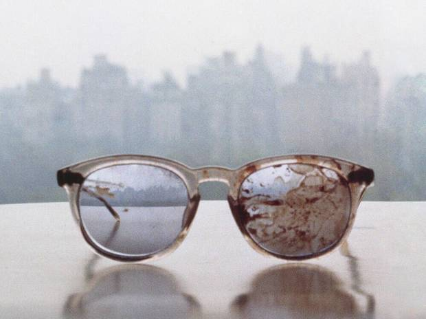 photo - Image of the glasses worn by John Lennon on the day he was shot and killed in 1980. Photo via NPR