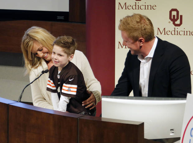 photo - Former Oklahoma State quarterback Brandon Weeden speaks at OU Medical Center Friday to celebrate the introduction of a new pediatric heart surgeon. Weeden has been a driving force behind recruiting that type of surgeon to Oklahoma because family friend Gavin Kuykendall needed to leave the state for complex heart care. PHOTO BY PAUL HELLSTERN, The Oklahoman