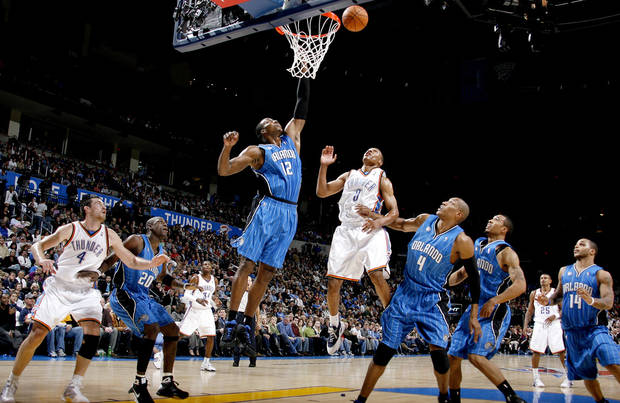 photo - Orlando's Dwight Howard tries to grab a rebound in front of Oklahoma City's Russell Westbrook during the NBA basketball game between the Oklahoma City Thunder and the Orlando Magic at the Ford Center in Oklahoma City, Wednesday, Nov. 12, 2008. BY BRYAN TERRY, THE OKLAHOMAN
