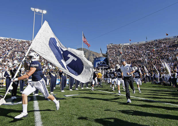 photo - Bronco Mendenhall leads BYU onto the field. AP photo