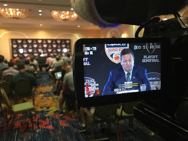 Image by Tim Money as he shoots Bob Stoops' press conference Wednesday morning in Florida.
