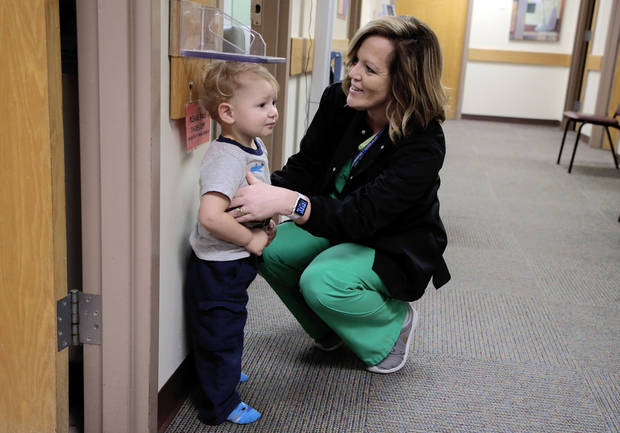 Sheree Dearman (right), a registered nurse at the Creek County Health Department, measures Trevor Turman, 1, at the health department, on Wednesday, Jan. 31, 2018. CORY YOUNG/Tulsa World