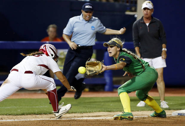 photo - Oklahoma's Erin Miller is thrown out trying to return to third with a tag by Oregon's Courtney Ceo in the tenth game of the Women's College World Series softball tournament between Oklahoma and Oregon at ASA Hall of Fame Stadium on Saturday, May 31, 2014 in Oklahoma City, Okla.  Photo by Steve Sisney, The Oklahoman