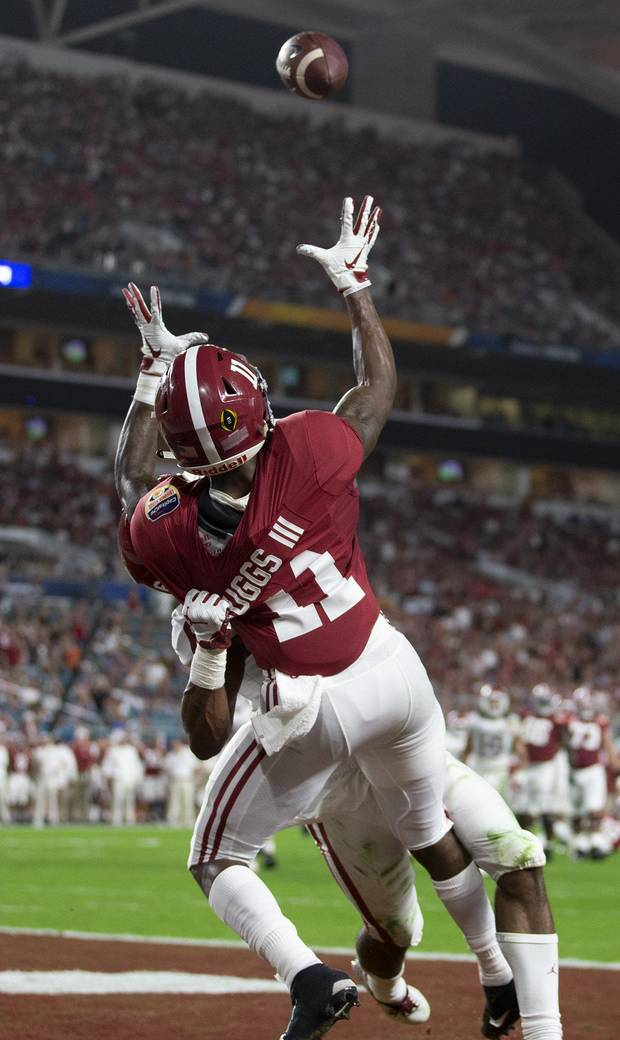 Oklahoma Sooners cornerback Tre Brown (6) can't stop a touchdown throw to Alabama Crimson Tide wide receiver Henry Ruggs III (11) in the College Football Playoff semifinals in the Orange Bowl at Hard Rock Stadium in Miami Gardens, Florida on December 29, 2018. [ALLEN EYESTONE/palmbeachpost.com]