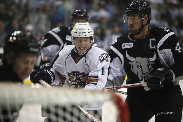 photo - AHL HOCKEY: Oklahoma City's Ryan Nugent-Hopkins (18) struggles with San Antonio players during a game between the Oklahoma City Barons and the San Antonio Rampage at the Cox Convention Center in Oklahoma City, Friday, Oct. 19, 2012.  Photo by Garett Fisbeck, The Oklahoman
