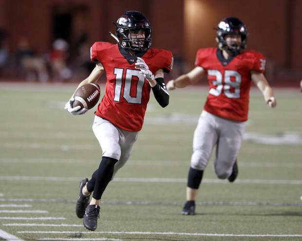 Westmoore's Andrew Metcalf returns a punt for a touchdown during a high school football game between Westmoore and Enid in Moore, Okla., Thursday, Sept. 26, 2019. [Bryan Terry/The Oklahoman]