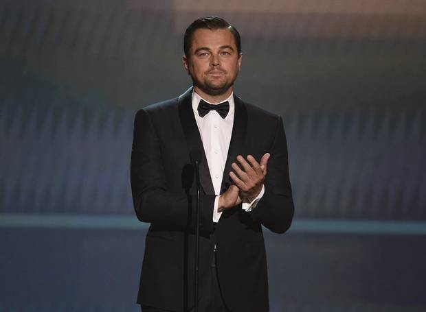 Leonardo DiCaprio appears on stage to present the lifetime achievement award at the 26th annual Screen Actors Guild Awards at the Shrine Auditorium & Expo Hall on Sunday, Jan. 19, 2020, in Los Angeles. [AP Photo/Chris Pizzello]
