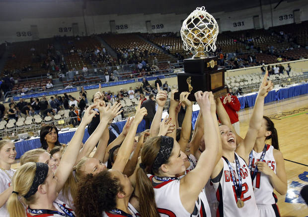 photo - Sulpher celebrates their win over Perkins-Tyron following the 3A girls state high school basketball championship at the State Fair Arena in Oklahoma City, Saturday, March 9, 2013. Photo by Sarah Phipps, The Oklahoman