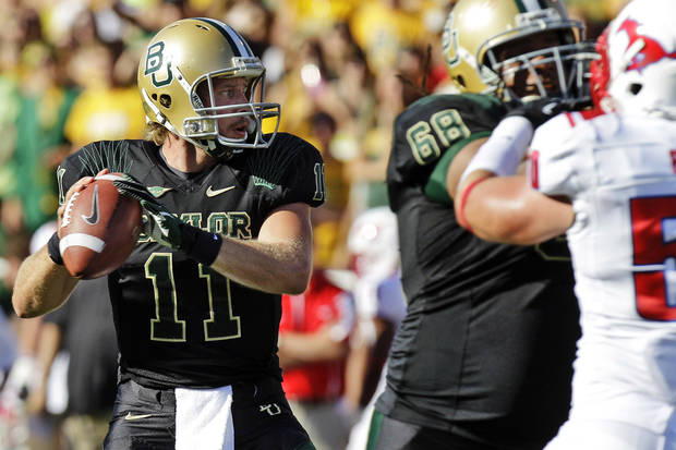 photo - Baylor quarterback Nick Florence (11) passes as offensive tackle Cyril Richardson (68) blocks Southern Methodist linebacker Cameron Rogers (50) during the first half of an NCAA college football game in Waco, Texas, Sunday, Sept. 2, 2012. (AP Photo/LM Otero) ORG XMIT: TXMO108